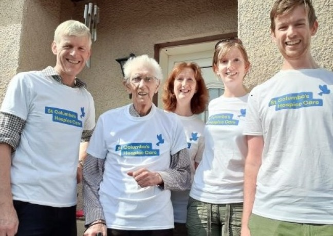 Picture of Bill Marshall, Bill, centre, walked 6.5 miles throughout July in memory of his wife. He was joined by his family to do the last quarter mile altogether.